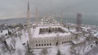 Aerial view of snowcovered buildings and Sultanahmet Square where Blue Mosque and Hagia Sophia are located after heavy snowfall in Istanbul Turkey on...