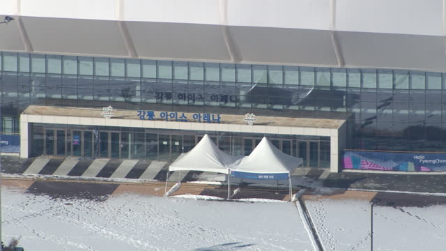 Aerial view of snow-covered Entrance of Ice Arena (Stadium for 2018 Winter Olympics)