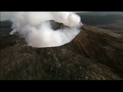 Aerial view of steam rising from volcano at Hawaii Volcanoes National Park / Hawaii Island, Hawaii