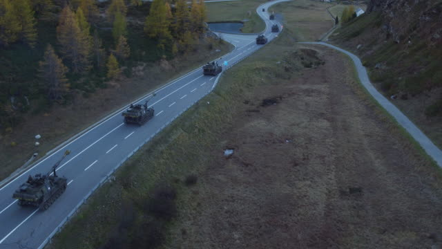 Aerial view of Switzerland army howitzer running
