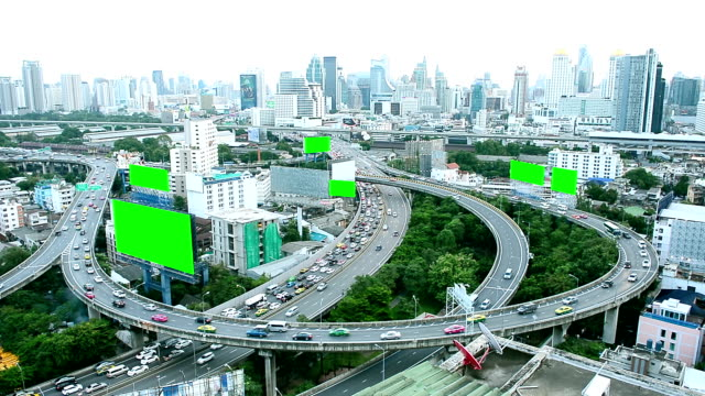 Aerial View Of Thailand City Building And Busy Traffic Road With Green Screen Advertising Billboards