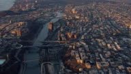 Aerial view of the Bronx and the Harlem River in New York City at golden hour.