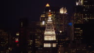 Aerial view of the illuminated spire of the Metropolitan Life Insurance Company Tower in New York City at night.