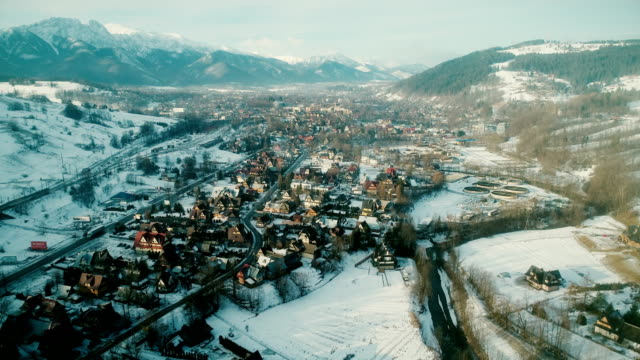 Aerial view of town in mountains in winter