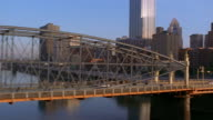 Aerial view of traffic on bridge with skyscrapers in background / Pittsburgh
