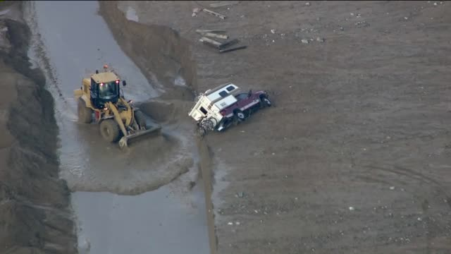 KTLA Aerial View of Vehicles Trapped on Highway 58 Near Mojave After Mudslides Inundated Roads