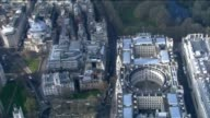 Aerial view of Whitehall ending on close up of Union Jack