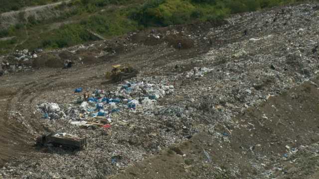 Aerial view of workers moving trash in garbage dump in Mexico City.