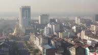 LS, HA Aerial view of Yangon skyline looking southwest towards Yangon port / Yangon, Myanmar