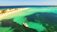 Aerial view of Yatch with friends in amazing, unspoiled and idyllic beach on a little island