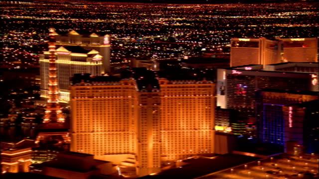 Aerial view over hotels North along the Las Vegas Strip past replica Eiffel Tower towards Wynn Las Vegas / night / Las Vegas, Nevada