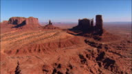 Aerial view over Monument Valley near Kayenta / King on the Throne formation / Utah/Arizona border