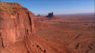Aerial view over Monument Valley near Kayenta / towards the King on the Throne formation / Utah/Arizona border