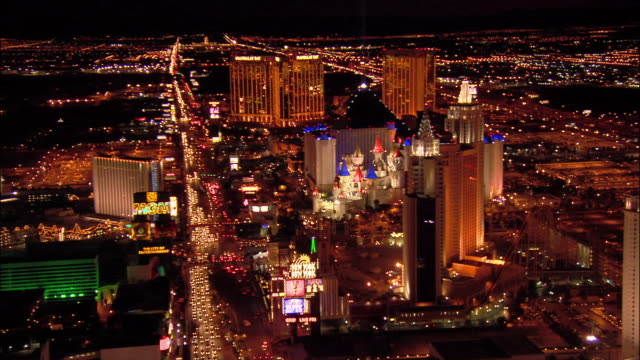 Aerial view over New York, New York and Excalibur hotels along the Las Vegas Strip / moving South over traffic on Las Vegas Boulevard  / night / Las Vegas, Nevada
