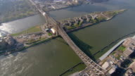 Aerial view over Queensboro Bridge from Manhattan over Roosevelt Island to Long Island City in Queens / New York City, New York