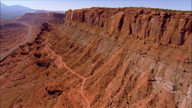 Aerial view over the Slick Rock 4 wheel drive trails through the canyons near Moab towards the Colorado River / Utah