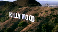Aerial view past Hollywood Sign / Los Angeles, California