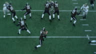 MS TS Aerial view Professional football quarterback calling play in huddle and taking snap and throwing pass from shotgun position