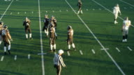 MS Aerial view Professional football referee placing football on line of scrimmage