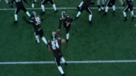 MS PAN Aerial view Professional football running back taking hand off and running through line of scrimmage