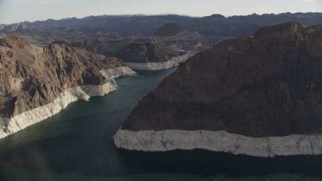 Aerial View Revealing The Hoover Dam Behind Mountains