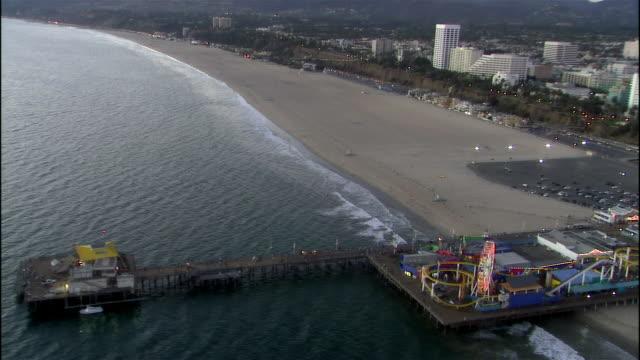Aerial view Santa Monica pier at sunset / pan cityscape / Santa Monica, California