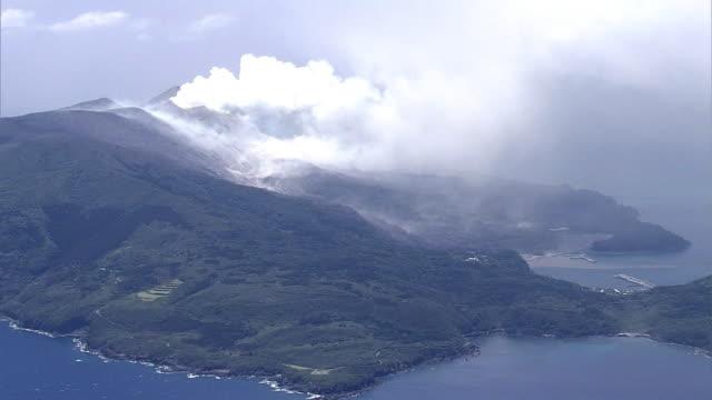 Aerial view Smoke plume coming out of Mount Shindake Long shot of the island
