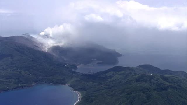 Aerial view Smoke rising from the erupting volcano Mount Shindake in the middle of Kuchinoerabujima