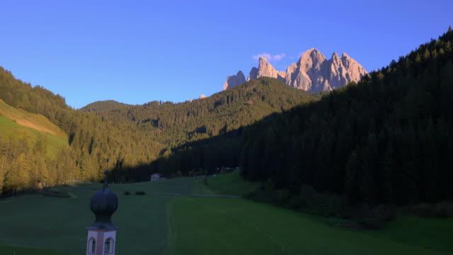 Aerial view St Johann chapel Alto Adige Dolomites