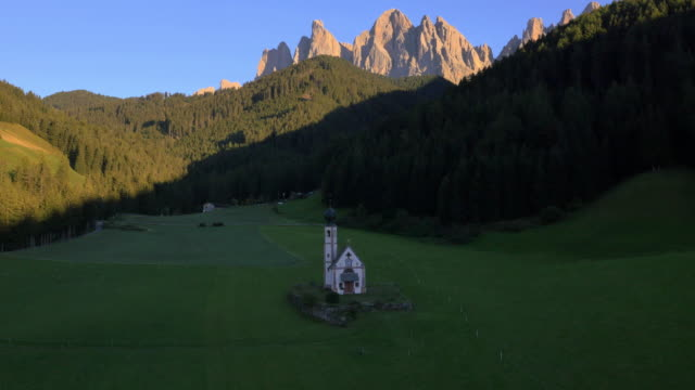Aerial view St Johann church Ranui Funes Valley