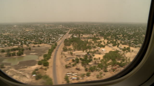 Aerial view through airplane window of landscape/ Chad