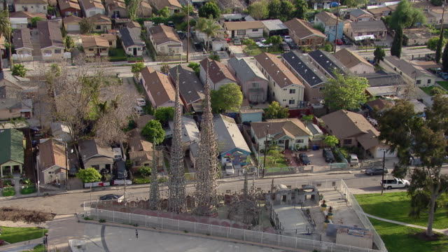 Aerial view tilting down over the famous Watts towers of South Los Angeles. The Towers are a local and national historic landmark.