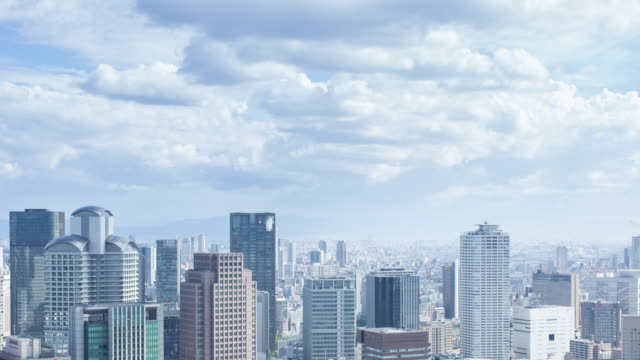 Aerial view time lapse of Osaka cityscape with clouds move
