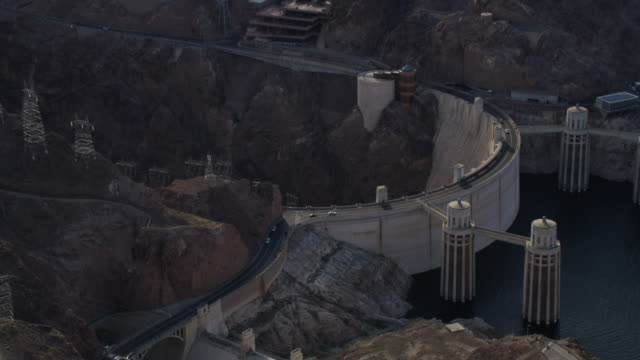 Aerial View Zooming Into Cars Driving Along The Hoover Dam