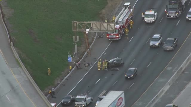 KTLA Aerial viewA 20yearold Burbank man whose body landed on an overhead exit ramp sign after a rollover crash near Griffith Park was passing...