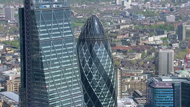 aerial views circling Gherkin skyscraper also shows The Shard