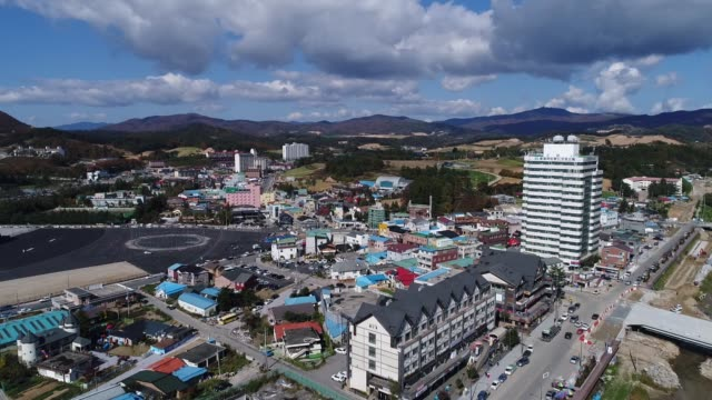 Aerial views of buildings taken above Hoenggyeri village area of Pyeongchang South Korea on Friday Oct 20 Aerial views of a bridge taken above...