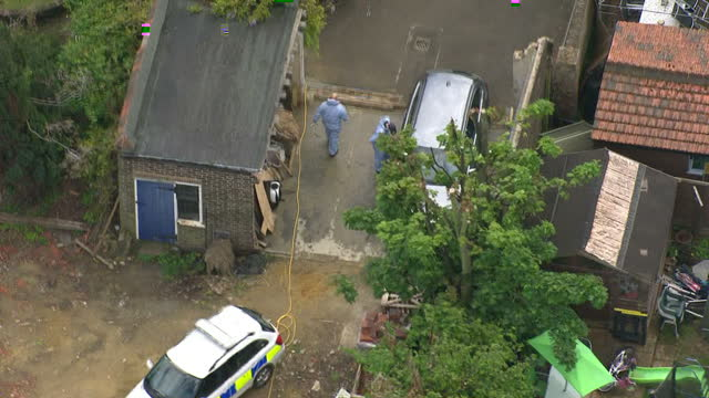 aerial views of forensic investigators searching area near Hatton Garden Heist suspect Brian Paul Reader's house in Dartford on May 20 2015 in London...