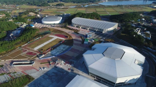 Aerial views of The Gangneung Hockey Center the venue for ice hockey events at the 2018 PyeongChang Winter Olympic Games right the Gangneung Oval the...