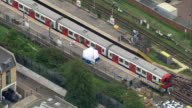 Aerial views of the train involved in the Parsons Green tube bombing and nearby trains being evacuated