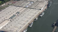 Aerial views over to the Excel Centre showing var military boats and ships moored alongside