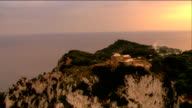 Aerial Villa Jovis (palace of Tiberius) on promontory of Capri overlooking Bay of Naples / Italy