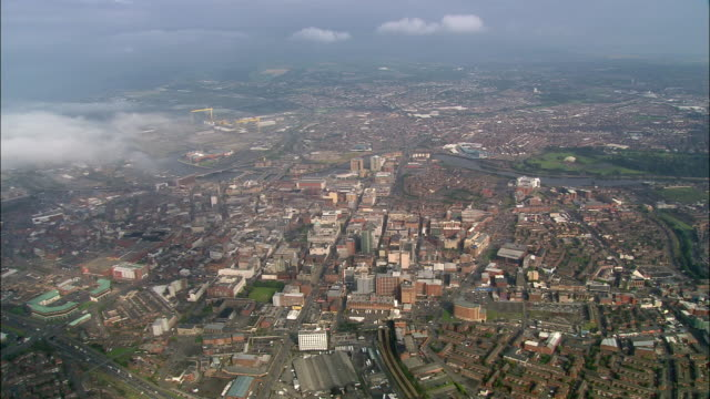 Aerial wide shot pan Belfast cityscape/ Northern Ireland