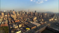 Aerial wide shot pan downtown from west side of midtown Manhattan/ New York, New York