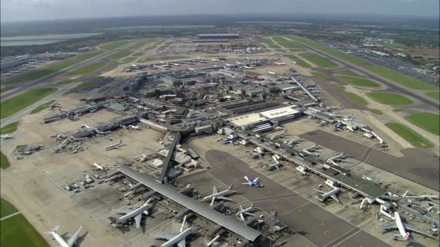 Aerial wide shot pan Heathrow Airport / London, England