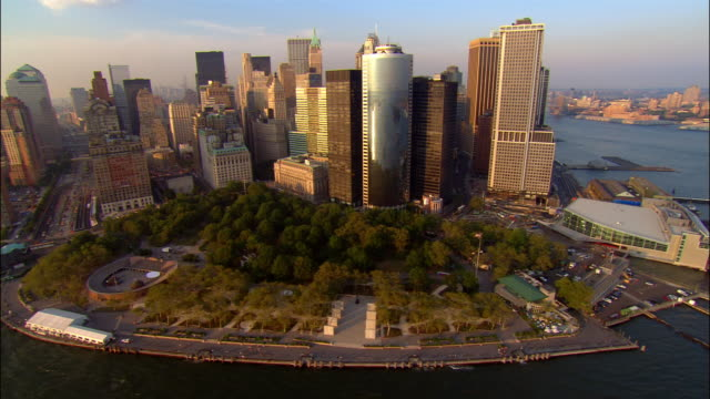 Aerial wide shot pan Lower Manhattan and Battery Park/ New York, New York
