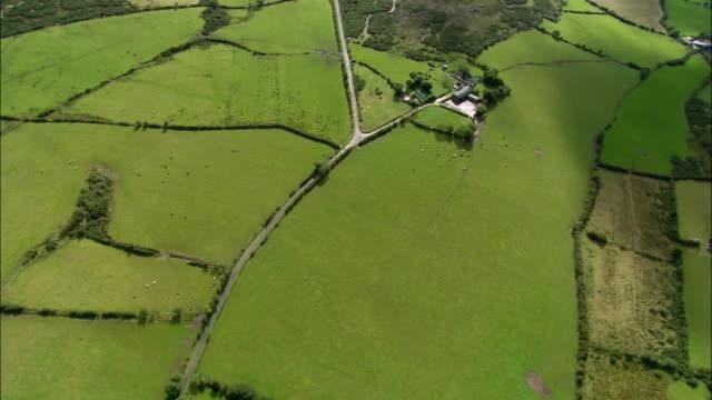 Aerial wide shot pan patterns in countryside / tilt up horizon / Strabane, Northern Ireland