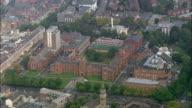 Aerial wide shot pan Queen's University and surrounding area/ Belfast, Northern Ireland