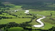 Aerial wide shot pan river in Galway / Ireland