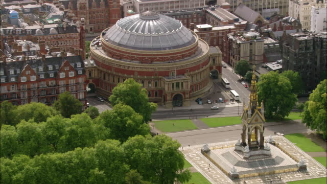 Aerial wide shot pan Royal Albert Hall and Prince Albert monument / London, England